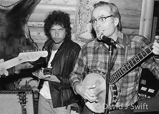 TWO LEGENDS: David J. Swift seems to know everyone in Jackson Hole. Here, years ago, he took a photo of a special guest musician joining Billy Briggs, player in the Stagecoach Band and  legendary skier who made the first ski descent of the Grand Teton. Moment was documented for posterity in a gig at Turpin Meadow Ranch.