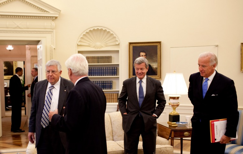 At a bi-partisan meeting in the Oval Office held in 2009 to discuss health care legislation, (l-r), President Barack Obama is seen in the background conversing with Sen. Charles Grassley (R-Iowa). In the foreground are Sen. Mike Enzi (R-Wyo), Sen. Chris Dodd (D-Conn.), Sen. Max Baucus, then chairman of the Senate Finance Committee, and Vice President Joe Biden.  Official White House Photo by Pete Souza
