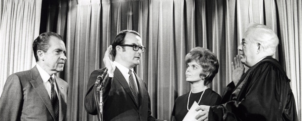 William Ruckelshaus being sworn in as the first chief administrator of the U.S. Environmental Protection Agency.  A policy institute, which promotes collaboration to solves disputes, bears his name at