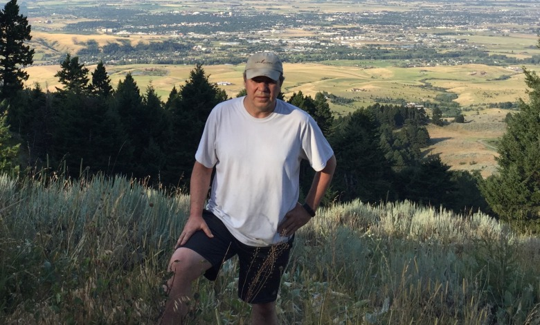 Planner and growth expert Randy Carpenter of FutureWest standing on public lands in the Bridger Mountains with Bozeman and the Gallatin Valley unfolding to his back. Todd Wilkinson photo.