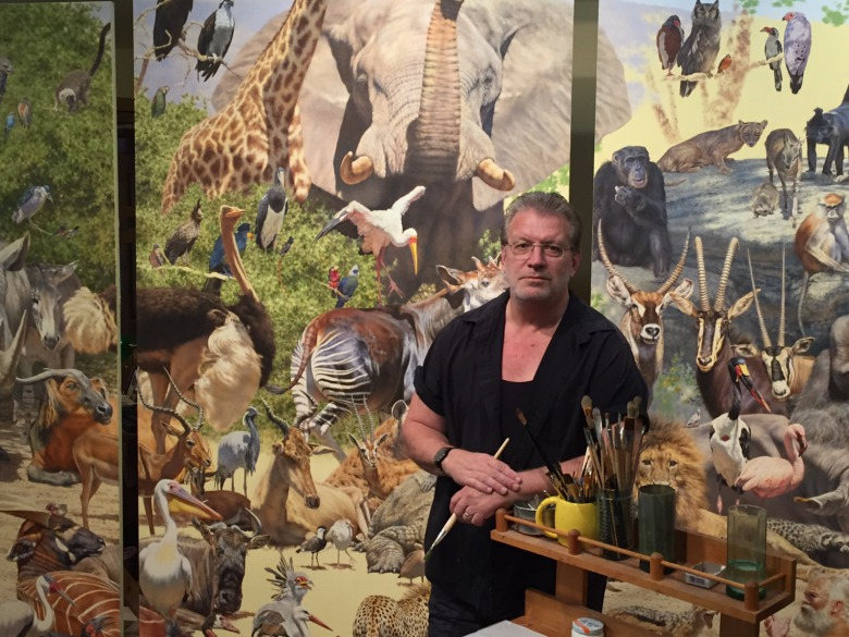 "Brian Jarvi in the studio completing his epic masterwork ""African Menagerie: An Inquisition"".  Featuring 209 species, it is 30 feet across and rises 1.5 stories."