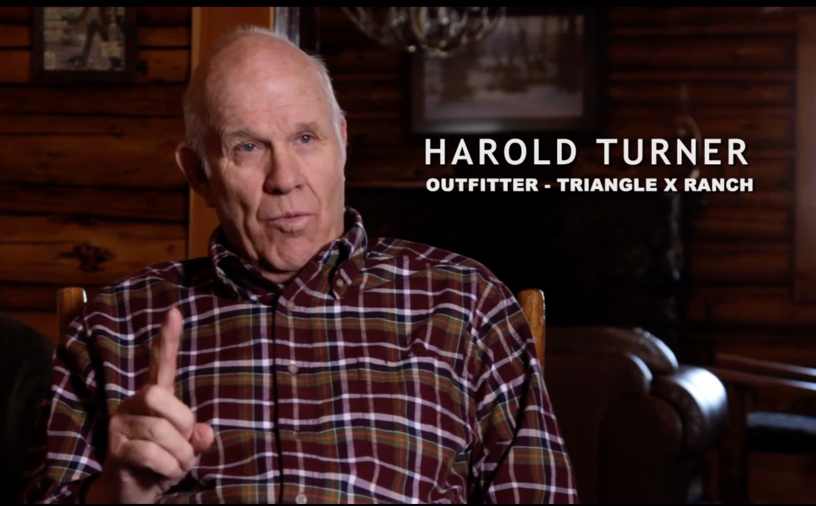 Screenshot of Jackson Hole outfitter and guide Harold Turner giving interview to filmmaker Danny Schmidt in his documentary Feeding The Problem. Mr. Turner vigorously opposes shutting down artificial feeding of elk.