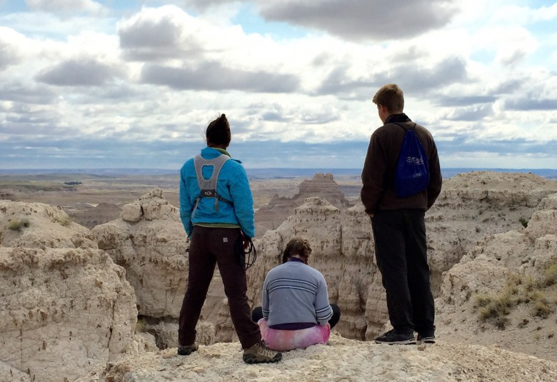 "Millennial-aged students, part of Whitman College's prestigious ""Semester in the West"" program stand in Badlands National Park on the Pine Ridge Indian Reservation. Millennials everywhere are standing up and making a difference.  Photo by Todd Wilkinson"