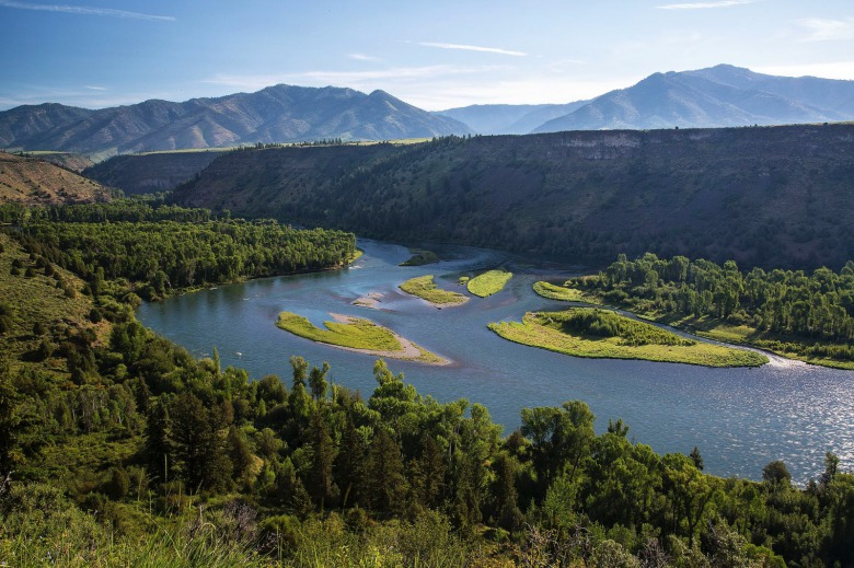 The South Fork of the Snake River in Idaho managed by the BLM. Imagine if, instead of it being protected, this popular stretch was lined by trophy homes and/or turned into a water park.  As Newcomb notes, unimpaired places always demonstrate their higher intangible value over time. And once they are gone you can't get them back.  Photo courtesy Bureau of Land Management.