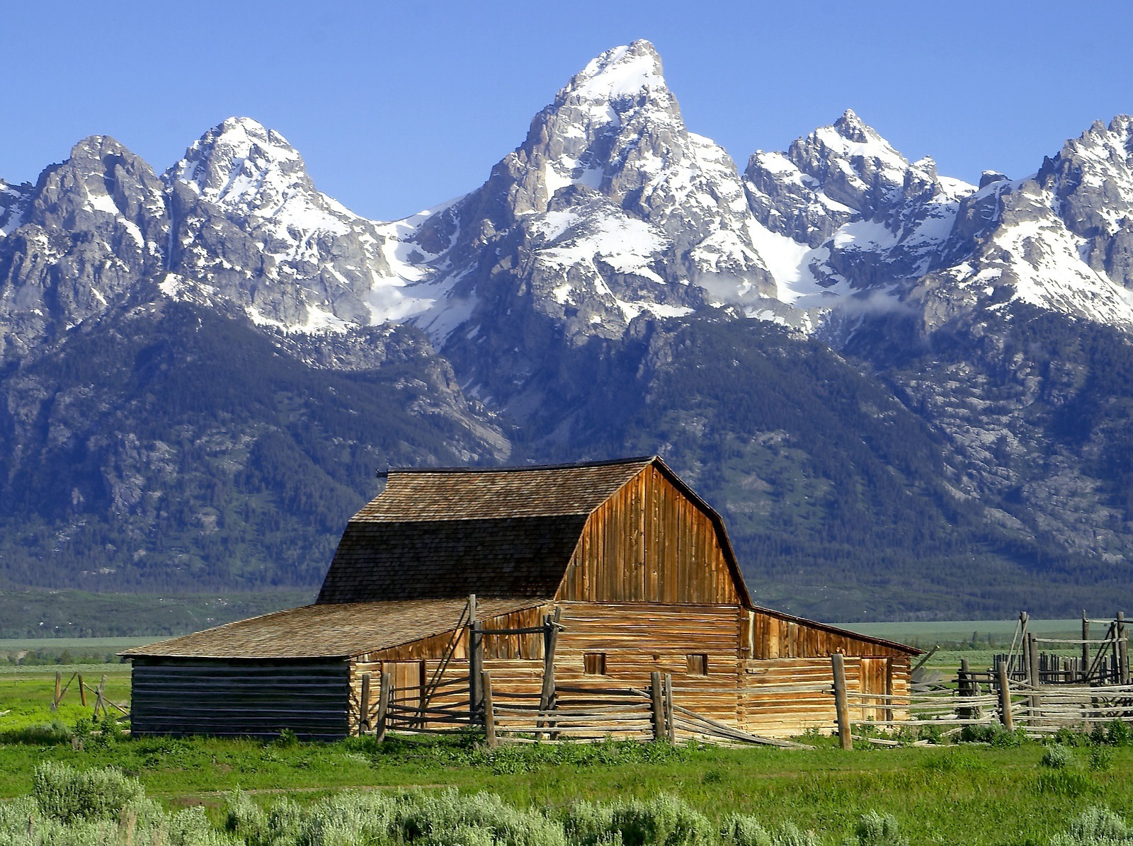 Moulton Barn fronts the Tetons in Grand Teton National Park. Protected lands, wildlife and a healthy environment have fueled Teton County becoming one of the richest counties in America.  A national park that started as a national monument, Grand Teton is a bold example of  the long-term dividends of conservation as opposed to the short-term whims of boom and bust.