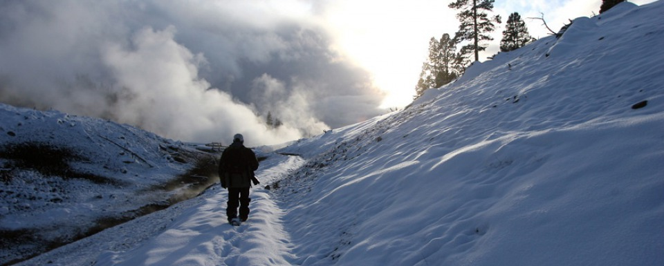 Winterkeeper Steven Fuller ventures into the geothermal mist of Yellowstone. Photo courtesy Kerry Huller
