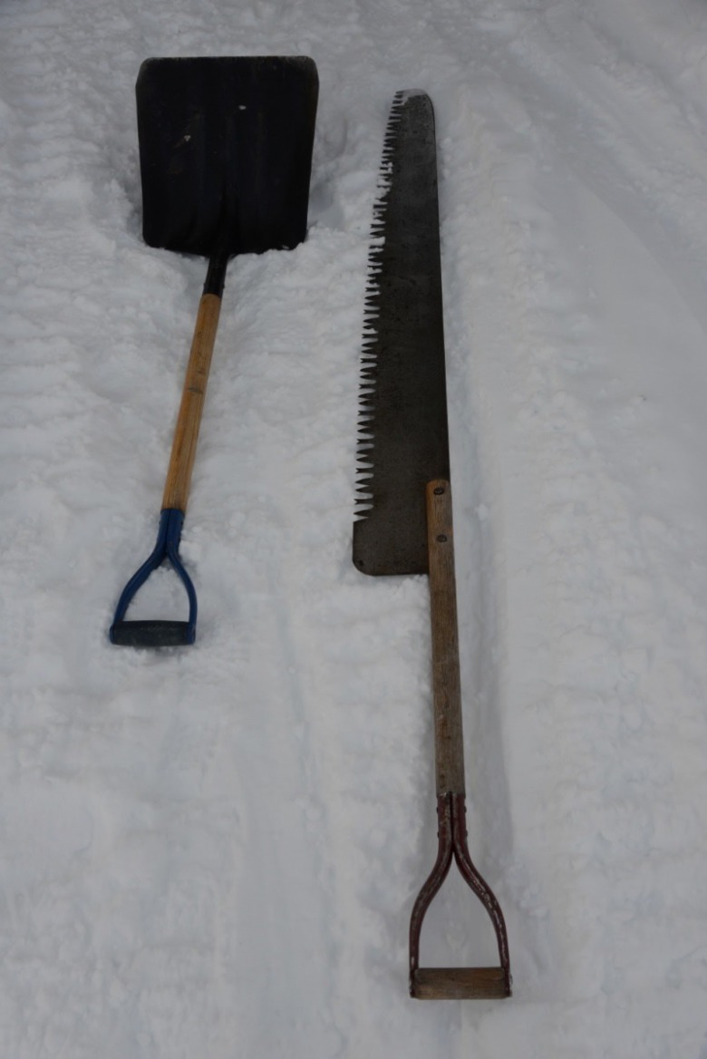 The winterkeeeper's humble tools of the trade. No snowblowers are taken up on a pitched roof.