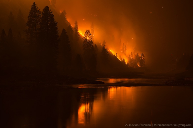 Tepee Springs fire of 2015 reflected in the Salmon River, Idaho. Photo by Jackson Frishman