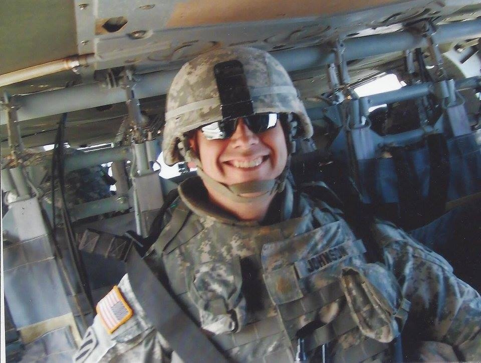 The author smiling in the back of a Black Hawk helicopter after the completion of another mission during operations in Iraq (2007). Photo courtesy Todd Johnson