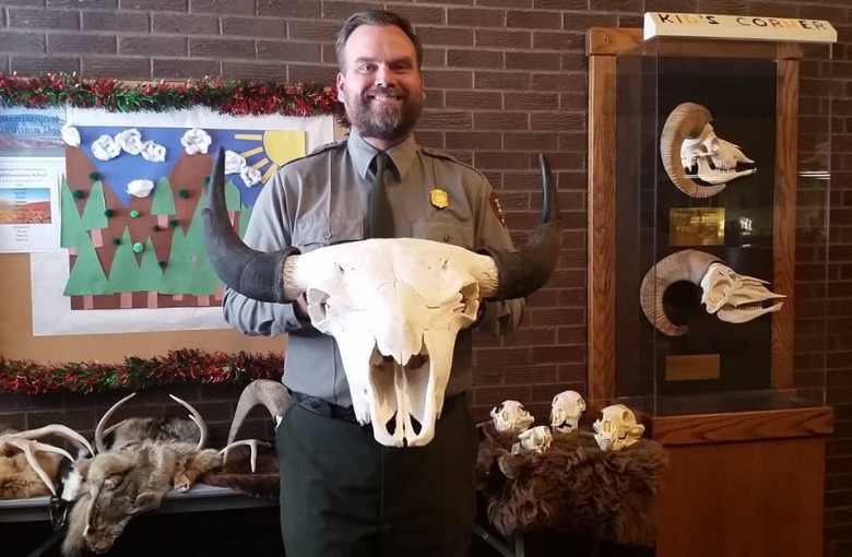 Displaying the newest addition, a bison skull, to the Bighorn Canyon's Education Corner
