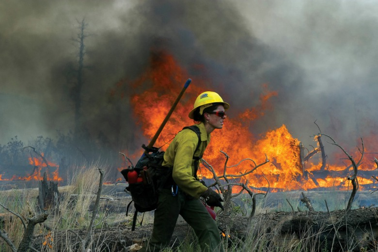 For women in U.S. land management and wildlife agencies, the struggle to be treated as equals has sometimes felt like marching into a wildfire. Photo courtesy Kristen Honig / NPS
