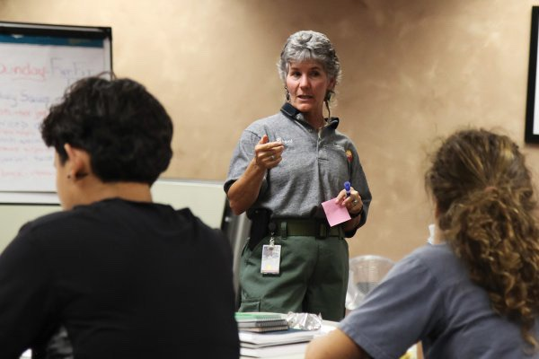 "Women have made some strides in attaining leadership positions in federal and state agencies but resistance from the good old boy culture remains a problem.  Here, Bequi Livingston leads the ""Women In Wildfire"" bootcamp, started in 2012 to empower women to break into the predominantly male wildfire corps. (Kristen Honig/National Park Service)"