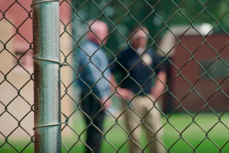 Corrections officials chat behind the fence at Pine Hills. All photos courtesy Montana State Fund