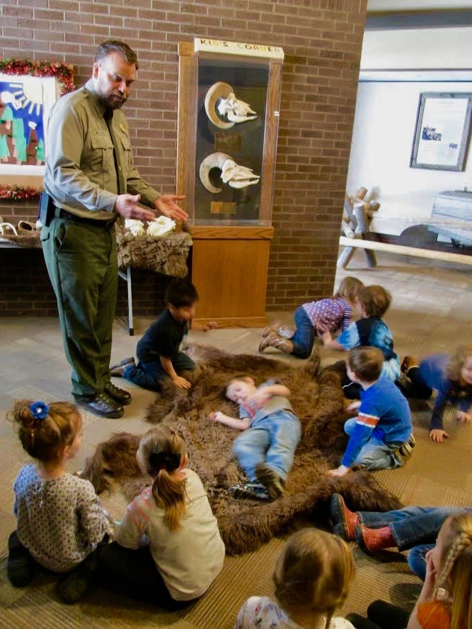 "As important as his military career was, Johnson takes his mission on the homefront equally as seriously. Here he's educating local school kids about wildlife, hoping to infect them with what E..O. Wilson calls ""biophilia.""  Photo courtesy Todd Johnson"