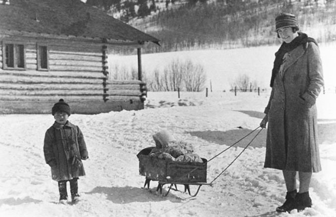 Martin Murie, left, with his sister in the sled, Joanne, being pulled by their mother Margaret E. Murie in Jackson Hole, 1930. Photo courtesy Murie Center, Moose, Wyoming
