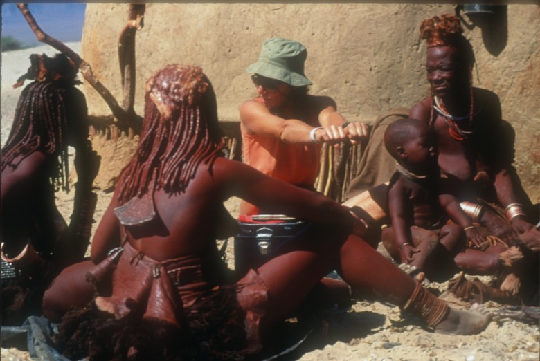 Dr. Margaret Jacobson in the Namibian village of Purros with her Himba friends, 1989. Photo courtesy Steven Fuller