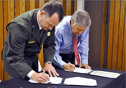 Choctaw Nation Chief Gregory Pyle and Cam Sholly sign a repatriation agreement officially transferring custody of 124 remains to the Choctaw Nation.