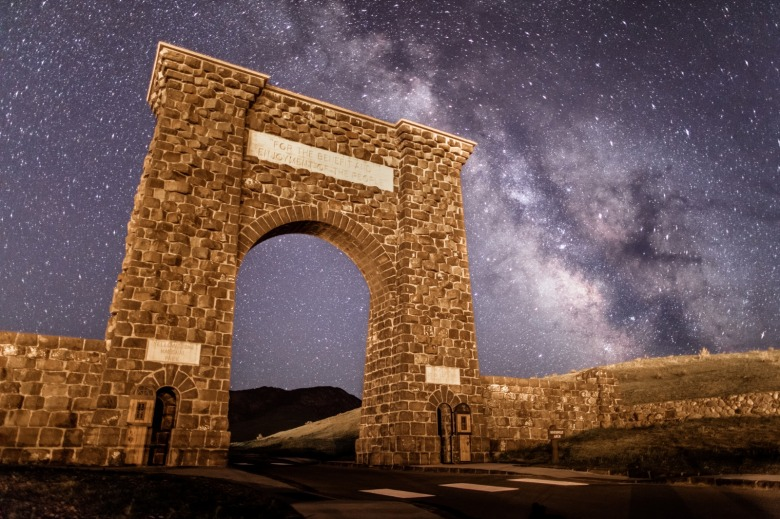 Yellowstone's Roosevelt Arch and its timeless slogan beneath the cosmos. Photo courtesy Jacob W. Frank/NPS