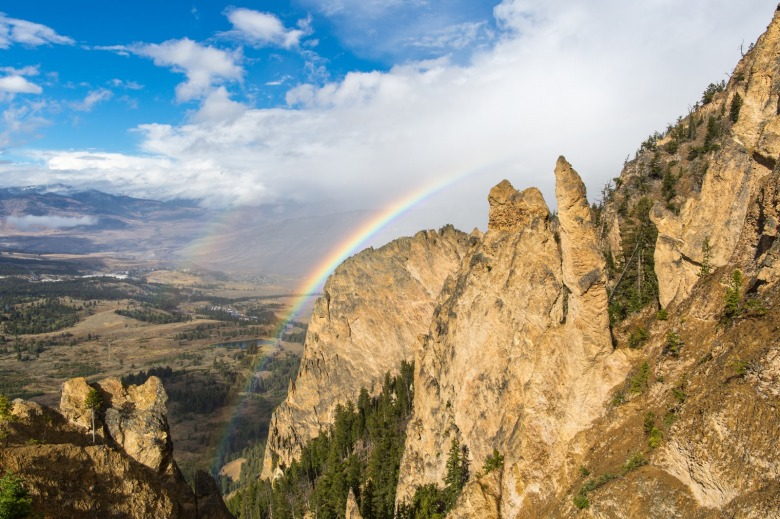 Rainbows from Bunsen Peak, Mammoth Hot Springs.  NPS / Neal Herbert
