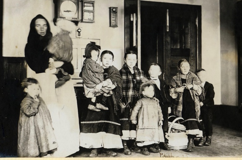 A Polish immigrant mother, not of great means or education, and her nine children pass through Ellis Island. Photograph courtesy National Park Service
