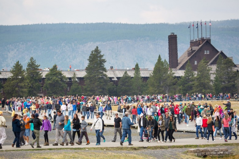 Crowds departing after watching Old Faithful Geyser erupt in Yellowstone. Photo courtesy Neal Herbert/NPS