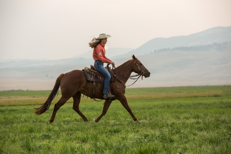 Irene Johnson rides her horse, Perky, on the U-Cross Ranch outside of Roy, Montana. Photo by Louise Johns