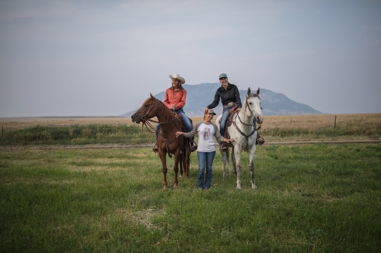Irene and Sadie Johnson with their mother, Nicole, on their home ranch, the U-Cross near Roy, Montana. Nicole Johnson and her husband Lance have been on this ranch for 18 years where they have raised their girls.  Photo by Louise Johns