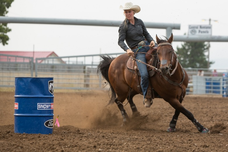 Sadie Johnson competes in a barrel racing event on her horse, Rocket, at the Lewistown Rodeo in August 2018, part of the Montana High School Rodeo Association. Sadie has been competing since 8th grade. Photo by Louise Johns