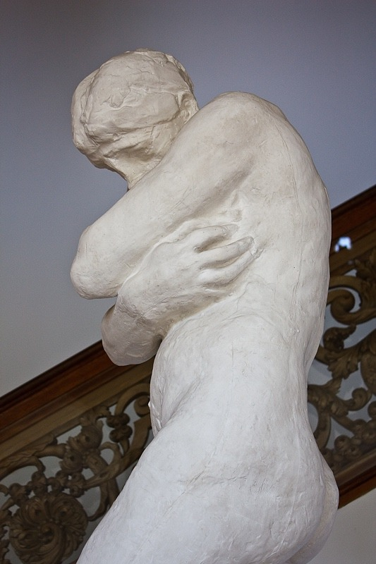 "Rodin's portrayal of Eve, hobbled by shame, after she and Adam ate from the forbidden fruit, commencing humankind's ""fall"" from innocence to becoming overwhelmed by guilt and shame"
