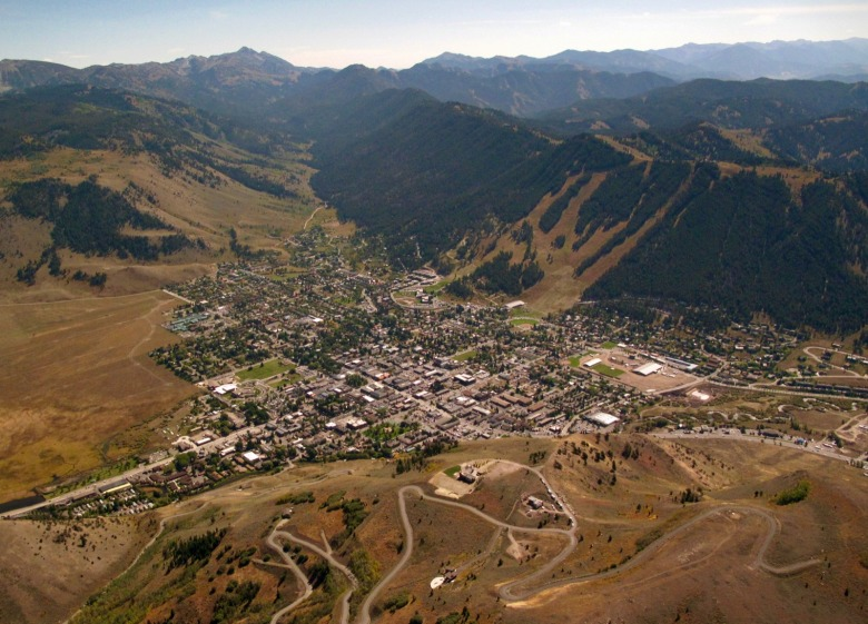 The town of Jackson, hub of Teton County, Wyoming and a busy hive of human activity, may look quaint from the sky.  However, the tentacles of its tourist-driven economy extend in every direction. Even though 97 percent of Teton County is comprised of public land, intense development pressure on private land has exerted direct impacts on wildlife and community character. A more insidious force is outdoor recreation putting more intense pressure on public lands. While the consequences of that have left many in denial, there is rising social angst over whether the wild essence of the valley can survive, observers say.  Photo courtesy EcoFlight (http://ecoflight.org)