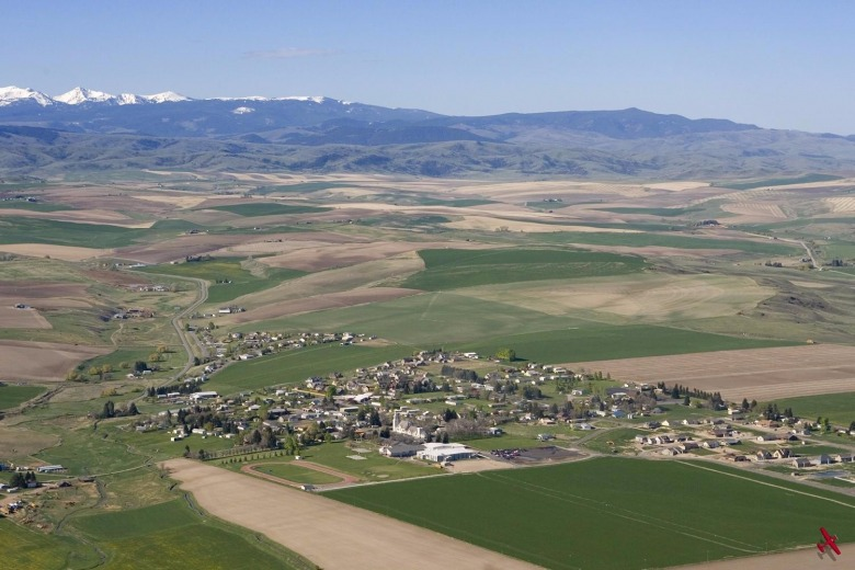 The farming community of Churchill in the middle of the Gallatin Valley.  Is this vision from the past a model for how to cluster growth in the future?  Churchill stands in sharp contrast to the scattershot development patterns sweeping across the Gallatin Valley from Bozeman.