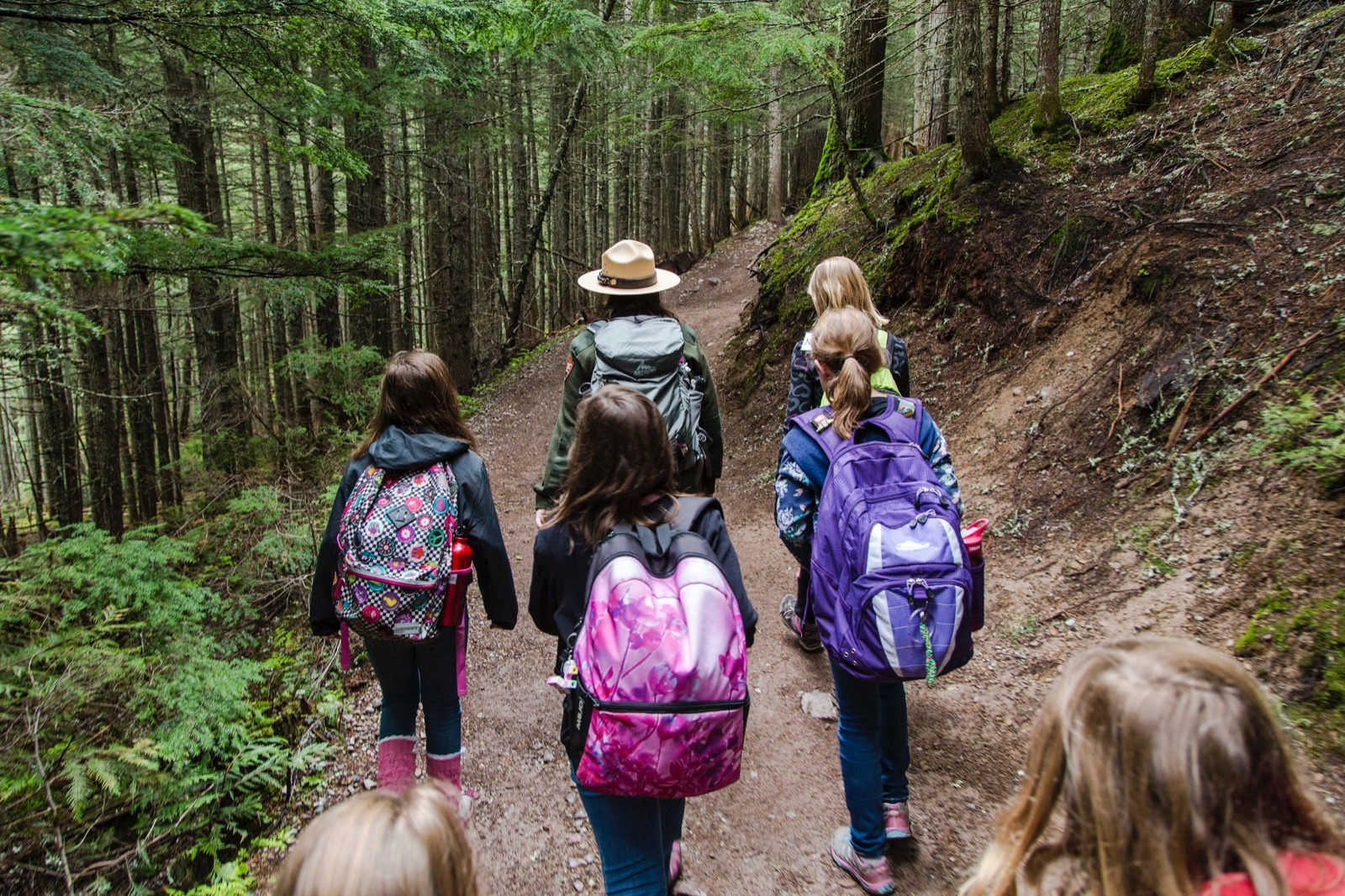 A park ranger leads children on a hike in Glacier National Park.  Photo courtesy Jacob W. Frank/NPS