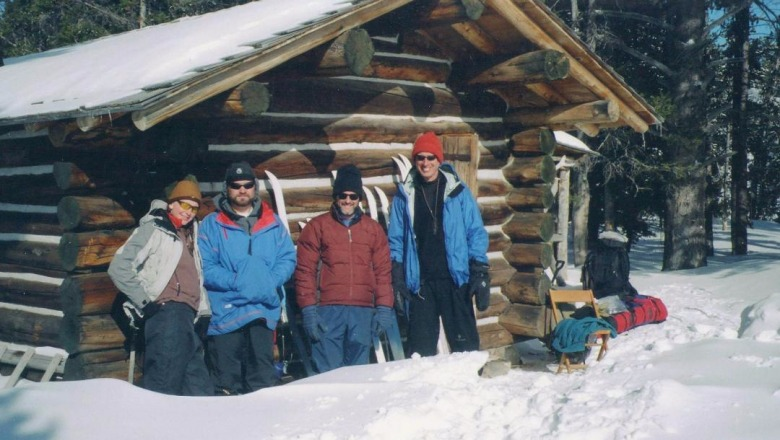 In 2006, Yochim, second from right, skiied with friends into the Yellowstone backcountry and are pictured here having lucnh at hte Pelican Springs Cabin. Joining Yochim were Stacey and Kerry Gunther (Yellowstone's chief grizzly bear biologist) and Steve Swanke, far right. Photo courtesy Michael Yochim