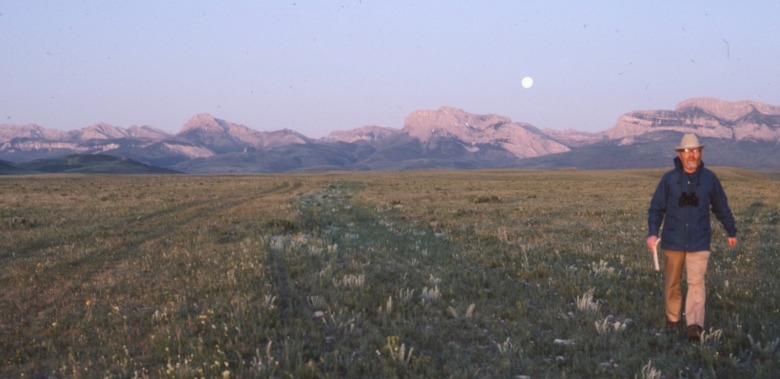 Doig pacing off shadow at dawn along the Rocky Mountain Front. Photo by Carol Doig, courtesy MSU Library Doig Collection