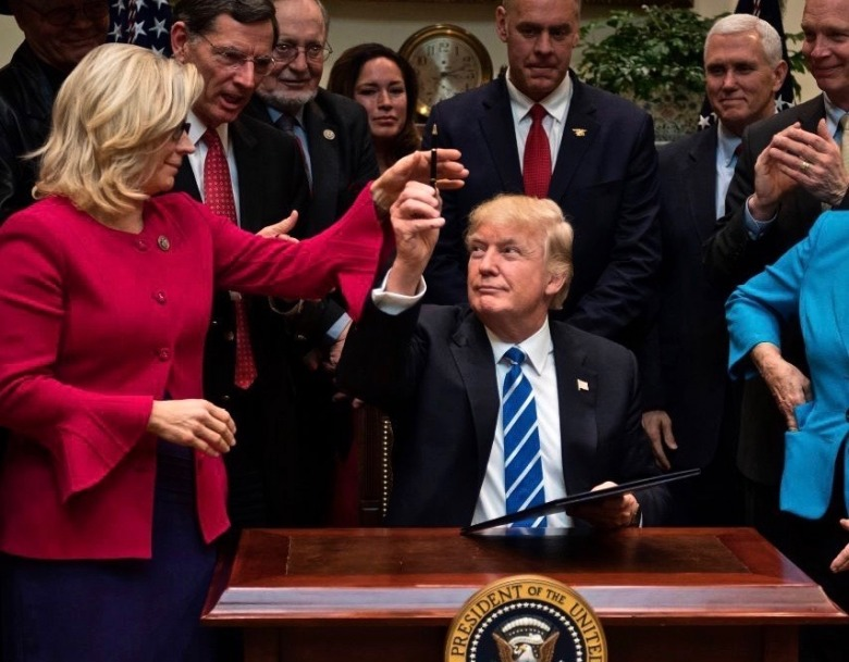 "President Trump gave Congresswoman Liz Cheney a pen after he signed an executive order removing regulations pertaining to coal and proclaimed that he would revive the coal industry in America. That hasn't happened—the coal market is plunging due to a glut of natural gas. Both the President and U.S. Rep. Cheney claim that human-caused climate change is based on ""junk science"" but they've provided no evidence, capable of withstanding scrutiny, to back it up.  Photo courtesy The White House"