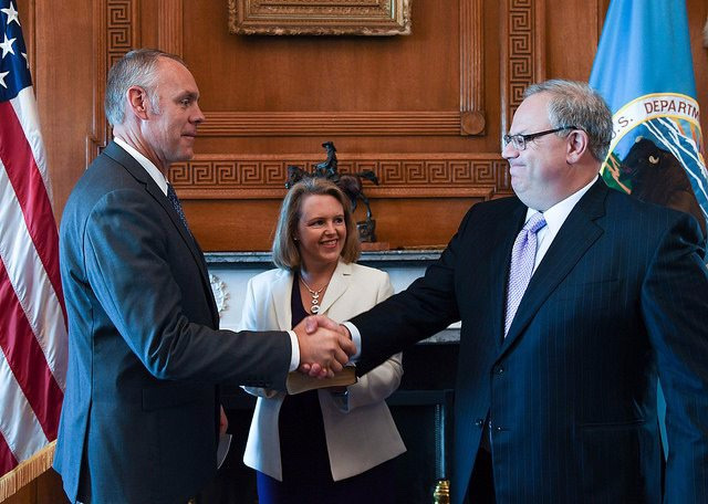 Prior to his resignation as Interior Secretary, Ryan Zinke welcomes David Bernhardt aboard to serve as his top undersecretary.  Months later, Zinke resigned his cabinet-level position amid several ongoing ethics investigations. President Trump chose Bernhardt to be Zinke's replacement.  Photo courtesy US Department of the Interior.