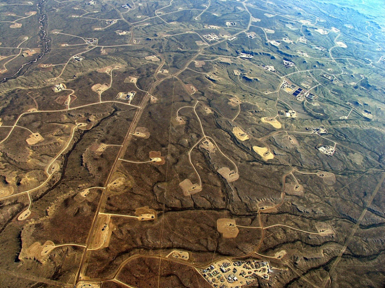 "Natural gas drilling pads pepper the Jonah Field and Pinedale Anticline in the southern tier of the Greater Yellowstone Ecosystem, causing severe impacts to migratory wildlife and their ancient corridors. Former Gov. Dave Freudenthal, after once inspecting the Jonah Field and lamenting the destruction of wildlife habitat, called it ""an example of what not to do.""  Photo courtesy Ecoflight (ecoflight.org)"