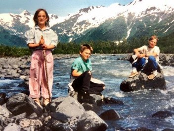 Emilie Saunders and her siblings getting their feet wet early on in Alaska.