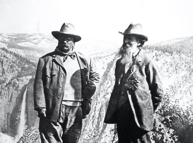 Theodore Roosevelt, left, and John Muir at Glacier Point in Yosemite, 1903. The same year he made a trip to Yellowstone and set down the cornerstone of what is today the Roosevelt Arch at the park's north entrance. During the Yellowstone trip, he shared company with naturalist and essayist John Burroughs. Photo courtesy NPS