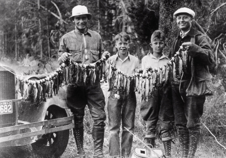 Decades before catch and release fishing regulations arrived in Yellowstone, anglers caught and kept as many trout as they liked.  This photo was taken in 1933 and represents the attitude of excess that was common in the era and reflective of park visitors who had a poor understanding of how nature has limits to human impacts. Photographer unknown/courtesy NPS