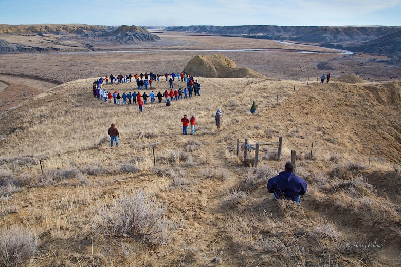 In 2006, members of the Blackfeet Confederacy gather for a round dance at the site of the 1870 Marias Massacre along the Marias River.  Photo courtesy Harry Palmer, licensed via Creative Commons NonCommerical-NoDerivs 3.0.  To see more Harry Palmer's work go to www.aportraitofcanada.ca