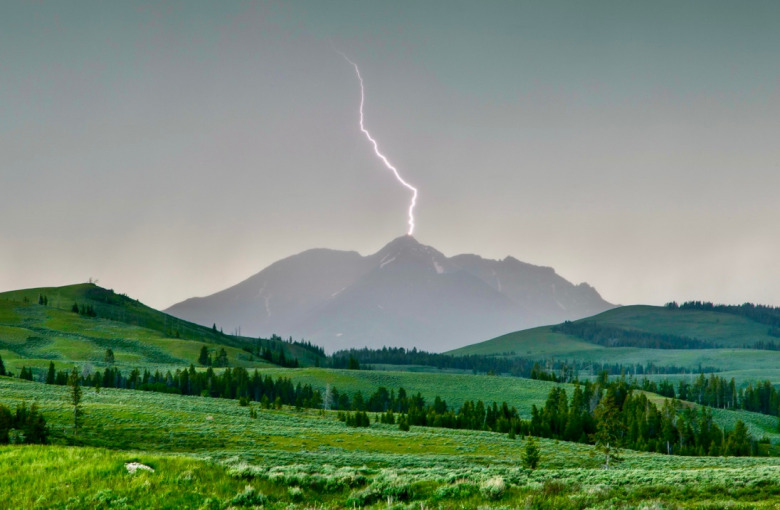 Lightning strikes Electric Peak during a thunderstorm passing over Yellowstone National Park. Photo by Neal Herbert/NPS