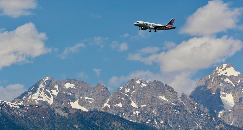 The tradeoffs of seeking prosperity: When Interior Secretary James Watt approved an extended special use permit for the Jackson Hole Airport in Grand Teton National Park in 1983, it not only cemented the presence of the airport but laid down the foundation for the facility to expand, the runway to be lengthened and number of flights to markedly increase.  A secondary impact is that it attracted fresh legions of second home owners and set off a development building boom. In addition, the fenced airport grounds represent a significant obstacle to wildlife movement and the sounds of jet aircraft detract from the setting. Photo courtesy Wikimedia/ WikiSniki17/Share-Alike 4.0 International License