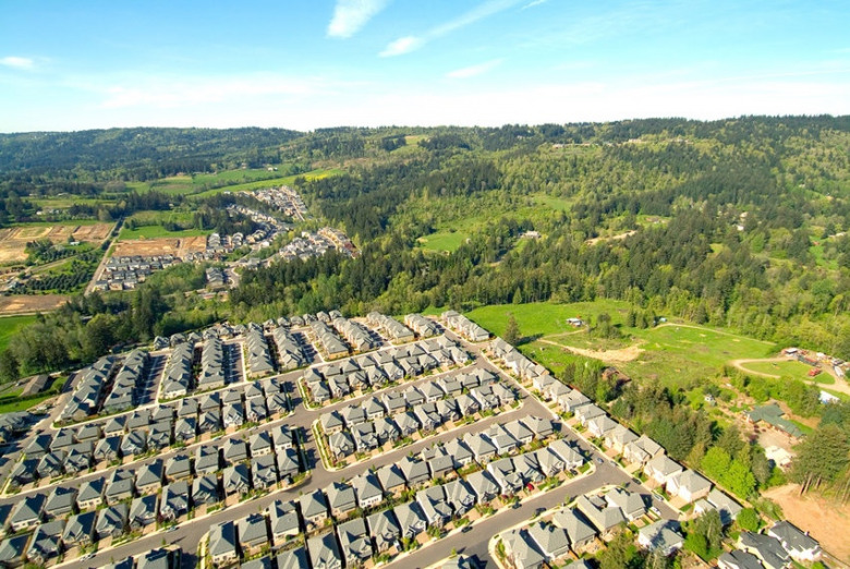 Another view of an urban growth boundary in Oregon where a town is surrounded by ag fields and forests, the latter without an invasion of homes that degrade wildlife habitat and are at high risk to loss from wildfire.