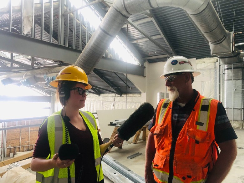 A reporter in the field of Indian Country: Taylar Stagnar visits the new Wellness Center being built at Poplar, Montana on the Fort Peck Reservation. Photo courtesy Taylar Stagner